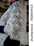 Small photo of White downy shawl on shoulders. Orenburg downy shawl