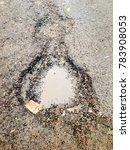 broken road full of water | Shutterstock . vector #783908053