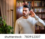handsome young man can't hear ... | Shutterstock . vector #783912337