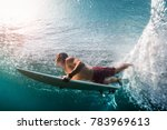 young surfer dives under the... | Shutterstock . vector #783969613