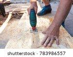 construction worker use jig saw ...   Shutterstock . vector #783986557