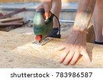 construction worker use jig saw ...   Shutterstock . vector #783986587