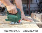 construction worker use jig saw ...   Shutterstock . vector #783986593
