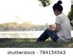 young women writing on...   Shutterstock . vector #784154563
