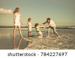 happy family walking on the... | Shutterstock . vector #784227697