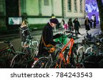 woman unlocking the bicycle... | Shutterstock . vector #784243543