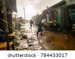boys running through african... | Shutterstock . vector #784433017