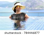 a tourist woman swims in an... | Shutterstock . vector #784446877