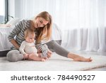 full length of smiling mother... | Shutterstock . vector #784490527