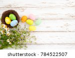 colorful easter eggs in nest...   Shutterstock . vector #784522507
