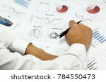 Small photo of Businessman Summary report and capital market plan analyzing money market plan,and Review accounting data and calculate order income.