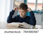 happy 8 years old boy doing his ... | Shutterstock . vector #784580587