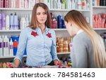 impatient saleswoman looking at ... | Shutterstock . vector #784581463