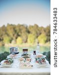 dining table at river and trees ... | Shutterstock . vector #784633483