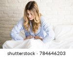 pretty girl wearing pajamas and ... | Shutterstock . vector #784646203
