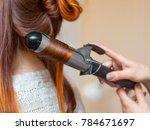 hairdresser makes hairstyle... | Shutterstock . vector #784671697