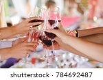 group of friend toasting with... | Shutterstock . vector #784692487