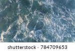 aerial view of waves at beach... | Shutterstock . vector #784709653