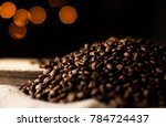 a lot of coffee beans for... | Shutterstock . vector #784724437
