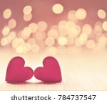 hearts on a wooden table and... | Shutterstock . vector #784737547