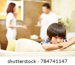 asian child appears sad and... | Shutterstock . vector #784741147