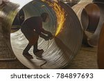 skilled metal worker grinding... | Shutterstock . vector #784897693