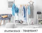 collection of clothes hanging... | Shutterstock . vector #784898497