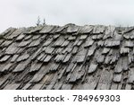 old wooden shingles on rooftop | Shutterstock . vector #784969303