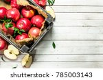 red apples in a box. on a white ... | Shutterstock . vector #785003143