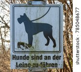 "Small photo of Sign with German text: ""Hunde sind an der Leine zu führen"" (Dogs are to be kept on a leash)."