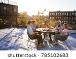 five friends sit talking at a... | Shutterstock . vector #785102683