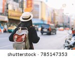 young woman traveler with... | Shutterstock . vector #785147353