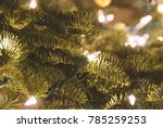 Small photo of Close up of white holiday lights on a green Douglass Fir Christmas tree with clear space for text and copy.
