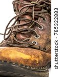 Small photo of Closeup of Men's Dirty Grimy Beat Up Brown Leather Work Boots with Long Laces Isolated on White Background