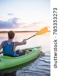 kayaker paddles out to sunset...   Shutterstock . vector #785353273