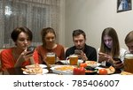 group of friends at dinner... | Shutterstock . vector #785406007