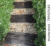 Small photo of Walkway is made from wood alternate with a little stone and press on two sides with a small green tree.