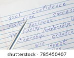 """pen pointing to the word """"time"""" ... 