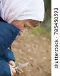 little girl carefully carving a ... | Shutterstock . vector #785450593