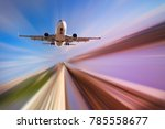 airplane in motion over roadway ...   Shutterstock . vector #785558677