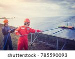labor working on cleaning solar ... | Shutterstock . vector #785590093