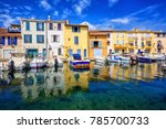 colorful houses reflecting in... | Shutterstock . vector #785700733