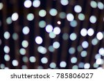 Small photo of silver and white bokeh from lights burb defocused. abstract background