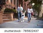 family taking a walk down the... | Shutterstock . vector #785822437