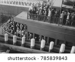 Small photo of Commuters on a ferry entering a 'slip', 1915-20. Commuters used ferries from New Jersey, Brooklyn and Staten Island to travel to Manhattan