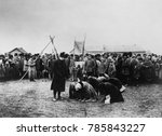 Small photo of American Relief Administration distributing food in the Volga District, 1921. Russian women abjectly kneel nearby