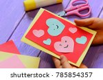 child is holding a valentines... | Shutterstock . vector #785854357