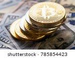golden bitcoin on money bills... | Shutterstock . vector #785854423