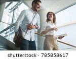 business colleagues looking at... | Shutterstock . vector #785858617