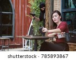 robber thief standing behind a... | Shutterstock . vector #785893867